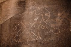 Rock carving, this of an Elephant, in Tadrart Acacus region of Libya date from 12,000 B.C. to 100 A.D., and reflect the dramatic climatic changes in the area.