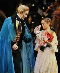 After the Nutcracker mended, Drosselmeyer comforts Clara (Will Tucket, Iohna Loots)
