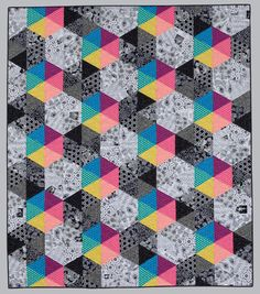 """black and white and colorful quilt by Jackie Kunkel, pattern in book, """"splash of color"""""""