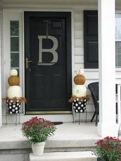 Fall porch. Love the black white and orange palette.