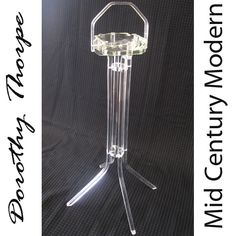 "On ebay now as ""Lucite Vintage Modern Dorothy Thorpe Ashtray/ PLAnt stand""....lovely!"