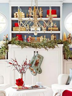 Save space by swapping out year-round photos, figurines, and knickknacks for your favorite holiday decorations. This bookshelf got a merry makeover from jolly snowmen, wrapped boxes, and a natural garland./