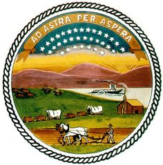 The Seal of the State of Kansas, which is on the State Flag, includes symbols of Commerce (the river and steamboat) and Agriculture (the farmer plowing). It was adopted in 1861.