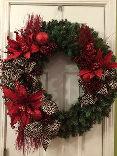 Items similar to Red and leopard Christmas wreath on Etsy Diy Christmas Door Decorations, Christmas Garlands, Burlap Christmas Tree, Christmas Crafts, Holiday Decor, Christmas Reef, Christmas Tree Design, Christmas Makes, Merry Christmas