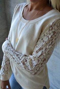 I think Im going to take an old sweatshirt and make it a pattern and make the sleeves from lace. I think this is going to be a good thing. Piace Boutique - Wish It Lace Sleeve Sweatshirt, $39.00