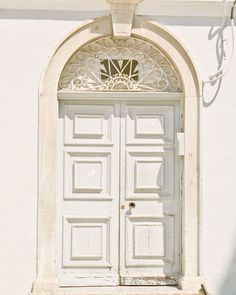 TITLE: The Pale Blue Door  LOCATION: Corfu, Greece      Always a favorite subject. Doors symbolize possibility, secrets, transitions. Light and bright in shades of white and the softest powdery pale blue.