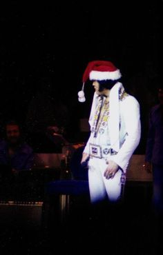 """Santa Elvis"" live on stage at the Hilton Hotel in Las Vegas, NV on Monday, December 6, 1976 (Thnx to Brian Petersen, author of ""The Atomic Powered Singer"" http://www.amazon.com/The-Atomic-Powered-Singer/dp/B002V9526U , who uploaded this beautiful shot to the ELVIS PICTURES group on fb.)"