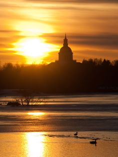 A duck couple is enjoying a swim while the sun is setting. There's some kind of church in the background as well :-p Sunset over Skelleftea river Native Country, Lappland, Countries Of The World, All Over The World, Rivers, Lakes, Finland, Travel Photos, Monument Valley