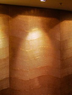 Textured wall painted with Copper metallic paint