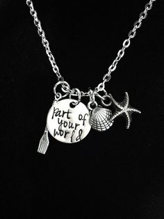 This necklace is inspired by The Little Mermaid. This necklace includes an engraved charm with the phrase part of your world along with a seashell,
