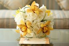 roses & yellow/tangy orange orchid bouquet. Coordination and design by Seasons of Life Events