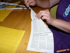 Tutorial on how to roll the paper in preparation for weaving