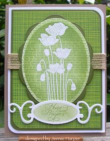 I would probably stamp text on after stamping (instead of using DSP) & embossing the white flowers, so that I could keep a white edge on my oval.