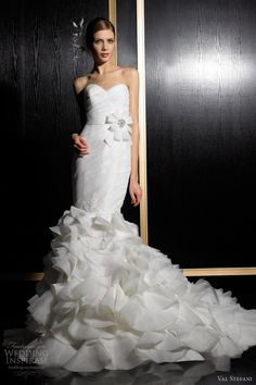 Lovely, romantic wedding dresses from Val Stefani Fall 2012 bridal collection.    Silky organza strapless mermaid gown with lace accents within the bodice and throughout the ruffled skirt and sash with subtle beaded detailing and a bow. A stunner!