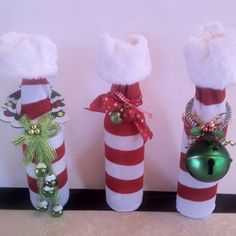 More wine bottle covers using dollar store socks and door hangers.  Love these.