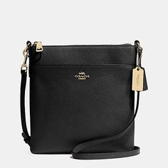 Updated in embossed leather with a delicate yet durable texture, the slender North/South Swingpack keeps valuables securely stowed for weekends and travel. It comes with an adjustable, edge-painted strap for a comfortable, hands-free carry.
