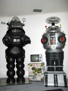 Robbie the Robot and the B9 Robot from Lost in Space. I wish I could have both of them in our house