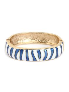 We love this fun twist on the nautical style. But instead of actual stripes, this glam bracelet features a chic zebra pattern in white and blue enamel.