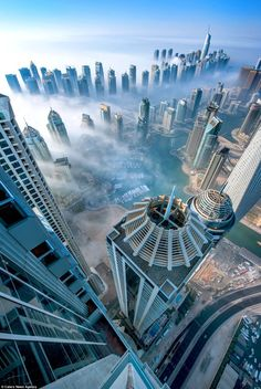 Photo of the Day: Dubai Shrouded in the Clouds at Dawn #architecture #skyscrapers #cityscape