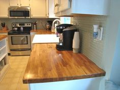 Butcher block countertop glass tile backsplash KitchenHome
