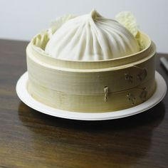 "At Drunken Dumpling, the XL Xiao Long Bao is ""the size of a bowl"" and comes with a straw for drinking the broth."