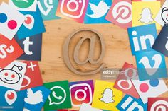 Foto de stock : Social media icons and at symbol on a wooden background Social Media Icons, Wooden Background, United Kingdom, Symbols, The Unit, Popular, High Resolution Picture, Pictures, England