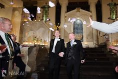 The grooms chose tuxedos with coordinating gray and sky blue details | InterContinental Chicago | Nakai Photography