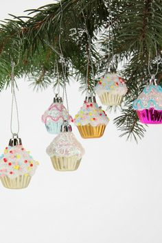 Spread mouth-watering holiday cheer with this sweet set of glittery cupcake ornaments!