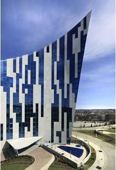 The Ascent, Covington, Kentucky. Daniel Libeskind. The building is a curved shape, the colors are crisp and clean and the solid void ratio works well. I particularly like how Libeskind treats the facade of the Ascent; it has a space age/tetris feel to it that helps make the building more interesting.