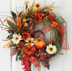 Here are the most ingenious Silk flower collections to make your event special. Source: Here are the most ingenious Silk flower collections to make your event special. Thanksgiving Wreaths, Autumn Wreaths, Holiday Wreaths, Thanksgiving Decorations, Fall Door Wreaths, Ribbon Wreaths, Fall Door Decorations, Tulle Wreath, Burlap Wreaths