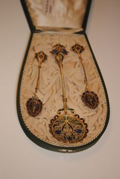 Gustav Gaudernack design for David Andersen. Three spoons in gilt silver with plique-a-jour floral design.