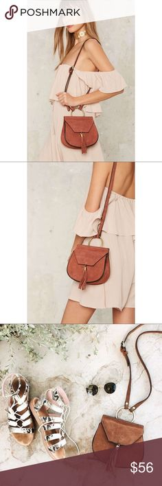 Nasty Gal x Nila Anthony Suede Bag in Rust Brown Get in the saddle—it's all for the West. This bag comes in a rust-colored brown suede, with a saddle silhouette, shoulder strap, and tassel at flap. Perfect for festivals, parties, dinners, errands, and everything else in your cal. Nasty Gal Bags Shoulder Bags