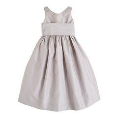 Straight from the pages of a storybook, this crisp silk taffeta dress is simple but sweet. A wide sash ties in a generous bow at the back, and a tulle underskirt gives it extra flounce. <ul><li>Fitted bodice.</li><li>Full skirt.</li><li>Falls below knee.</li><li>Silk taffeta.</li><li>Hidden side zip.</li><li>Lined.</li><li>Dry clean.</li><li>Import.</li><li>Online only.</li></ul>
