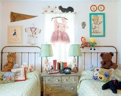 White walls with pops of color. And I love those beds. And the symmetry of the room.