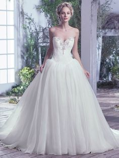 Maggie Sottero - GINNY, Exuding refined Victorian beauty, this Chic organza ball gown with lace bodice featuring Swarovski crystals and embellished accents along a sweetheart neckline makes a grand statement. Finished with a corset closure.