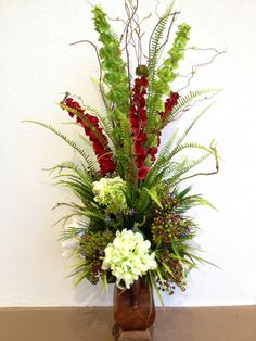 Bell of Ireland, berry, grass, willow and hydrangeas. Designed by Arcadia Floral and Home Decor.