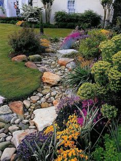 Front Yard Landscaping A dry riverbed and creek bed landscaping may be actual work of art. A prosperous rock garden takes quite a little planning! Arranging a garden or yard with landscaping riverbed or creek bed isn't a…MoreMore Landscaping With Rocks, Front Yard Landscaping, Landscaping Ideas, Dry Riverbed Landscaping, Backyard Ideas, Acreage Landscaping, River Rock Landscaping, Landscaping Contractors, Landscaping Melbourne