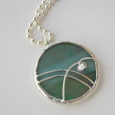 Green Iridescent Abstract Circle Stained Glass Pendant Necklace. $15.00, via Etsy.