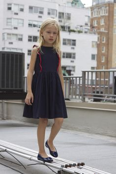 Your little girl is party ready with this cute pinafore dress by Natty. With contrasting trim and delicately finished with petite French seams, this dress is a beauty on the inside and out. | Proudly made in New York City by Nattyny.com