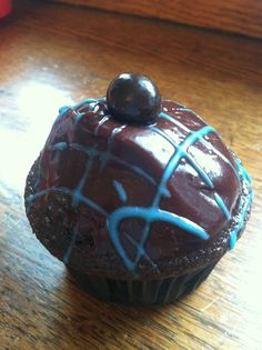 Dark chocolate blueberry cuppies, doubled dipped in ganache and topped with a chocolate covered blueberry