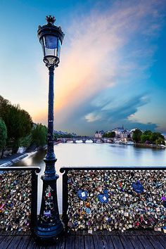Love Locks on Bridge over River Seine, Paris France.