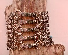 Chainmaille cuff bracelet with faceted beads https://www.etsy.com/ca/listing/214103486/handmade-tinned-copper-4-in-1?ref=shop_home_active_12