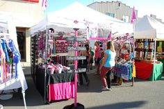 photos of antique fair booth outside | results craft shows are filled with vendors selling a variety of goods ...