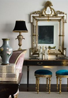 beautiful antique mirror, Foo dogs and teal stools!