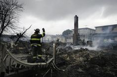 A fire fighter surveys the smoldering ruins of a house in the Breezy Point section of New York, Tuesday, Oct. 30, 2012.
