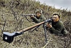 Russian Soldiers with a Mosin Nagant & PTRD 14.5x114mm Antitank rifle.
