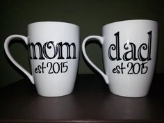 This purchase is for one coffee mug that either reads mom or dad with est and the year underneath in black vinyl lettering. If you need one for