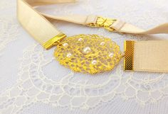 Ivory elastic waist belt with gold oval buckle. by MissLaceWedding