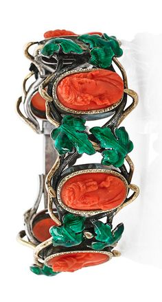 "FRENCH CORAL, CAMEO & ENAMELED SILVER IVY BRACELET,Six oval carved coral Neoclassical female busts among scrolling green enameled silver and applied yellow gold naturalistic ivy vine. Mid-late 19th c. French control marks for 800 silver, unidentified maker mark ""AL""."