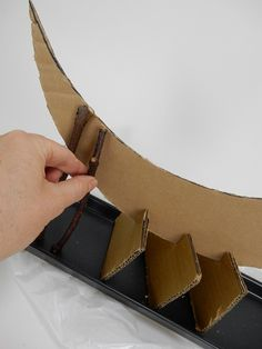 Measure the sticks against the cardboard and cut and glue.